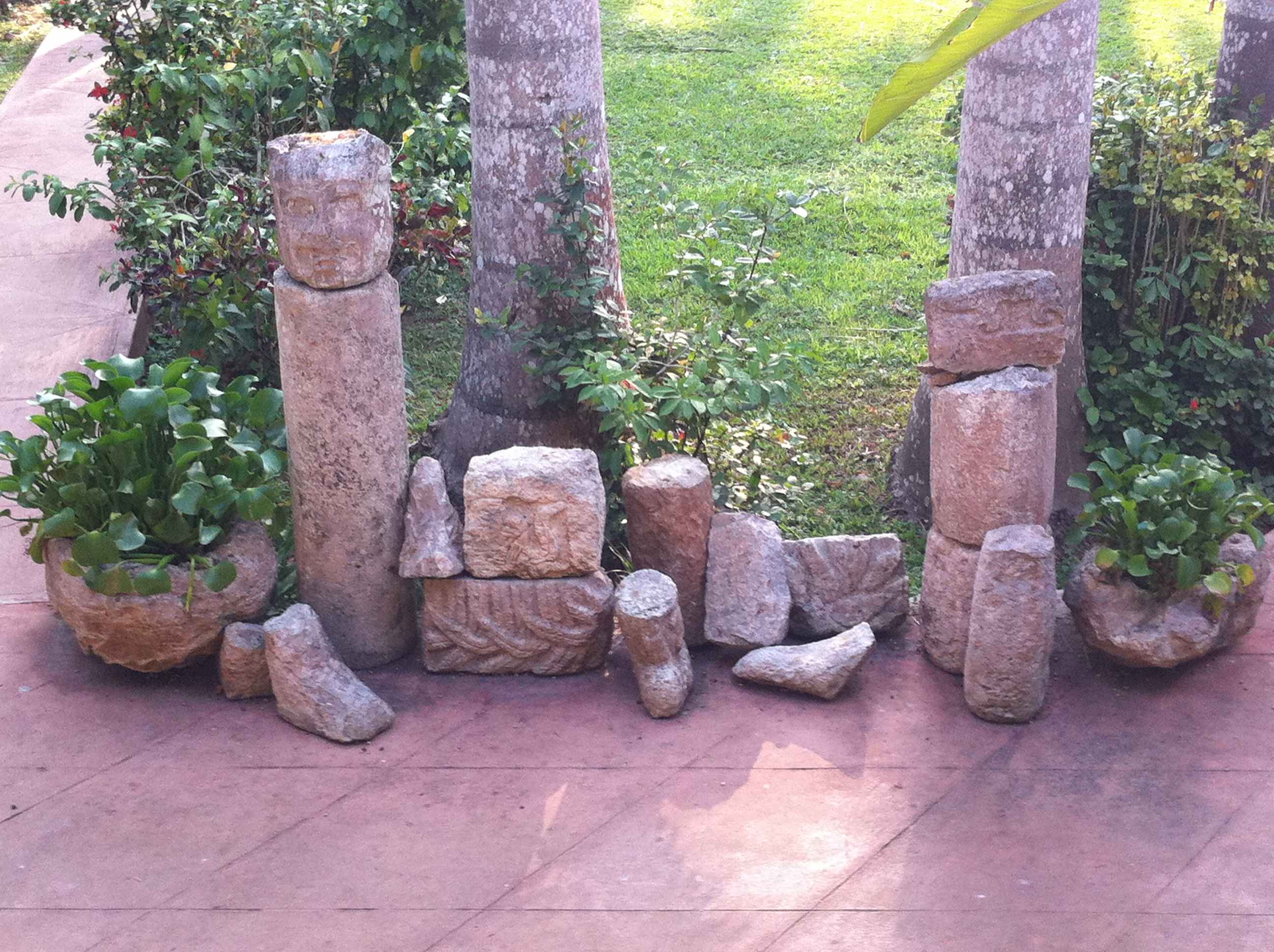 Sculpted stones from Chichén Itzá in the hacienda courtyard